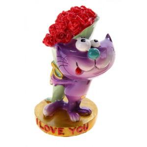 Фото статуэтки кота с букетом цветов